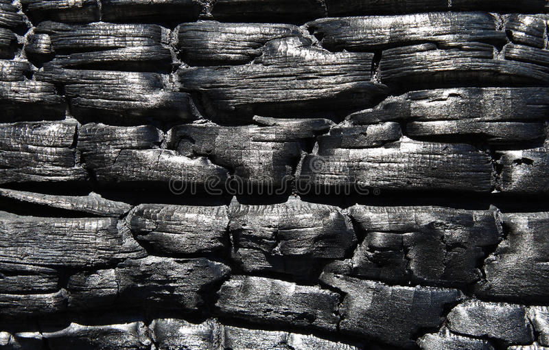Charred wood, as a background stock images