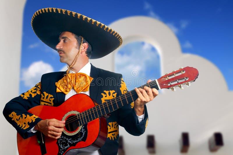 Charro Mariachi playing guitar Mexico houses royalty free stock photo