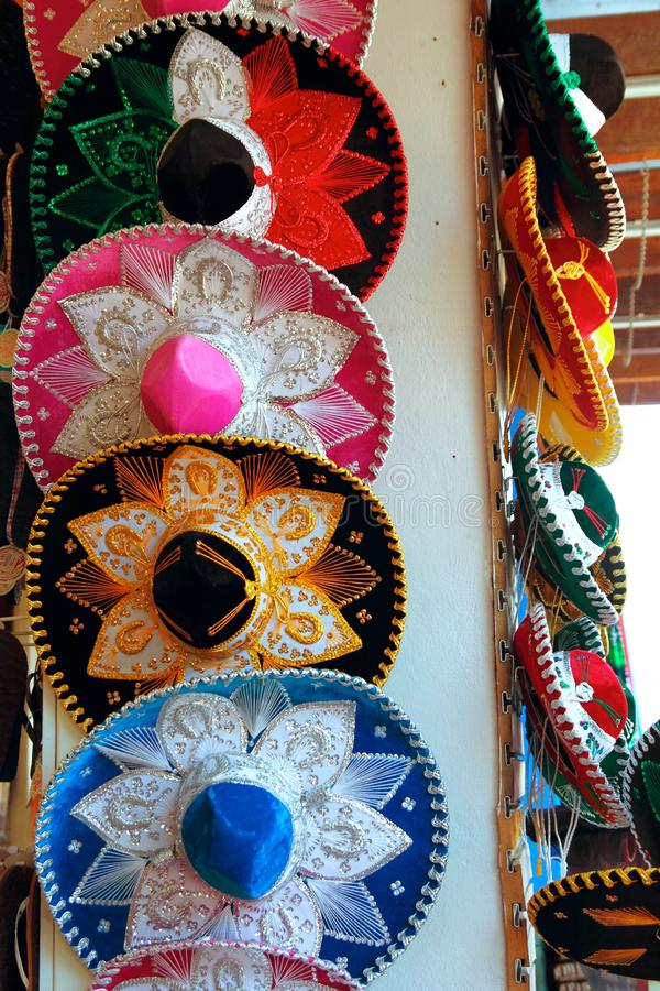 Charro Mexican mariachi colorful hats. In row royalty free stock photo