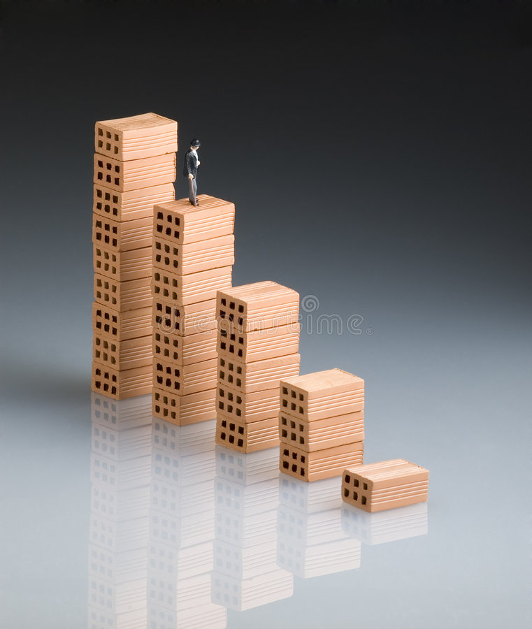 Chart of bricks. Businessman in a chart of bricks stock image