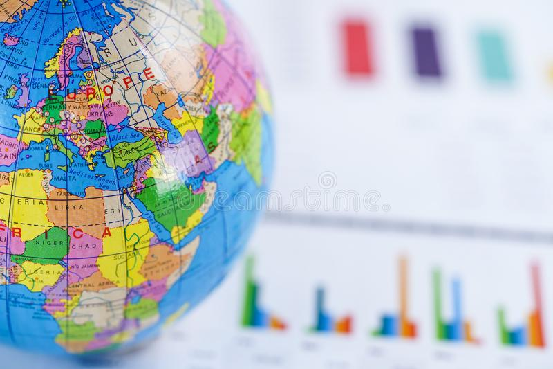 Chart graph paper with globe world Europe map on . Finance, Account, Statistics, Investment, Analytic research data economy. royalty free stock images