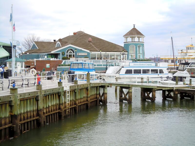 Restaurant building and harbour on riverside. The Chart House Restaurant and small harbour on the Potomac River in Alexandria, Virginia in the United States of stock photo