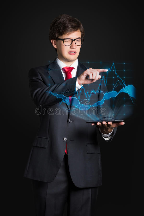 Chart interface. Businessman holding touch pad with chart interface royalty free stock photo