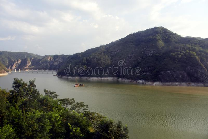 Qinling Mountains: scenery on the north south boundary of China. The chart shows the river hydrology, Qinling to Huaihe River south of the rich flow, seasonal royalty free stock image