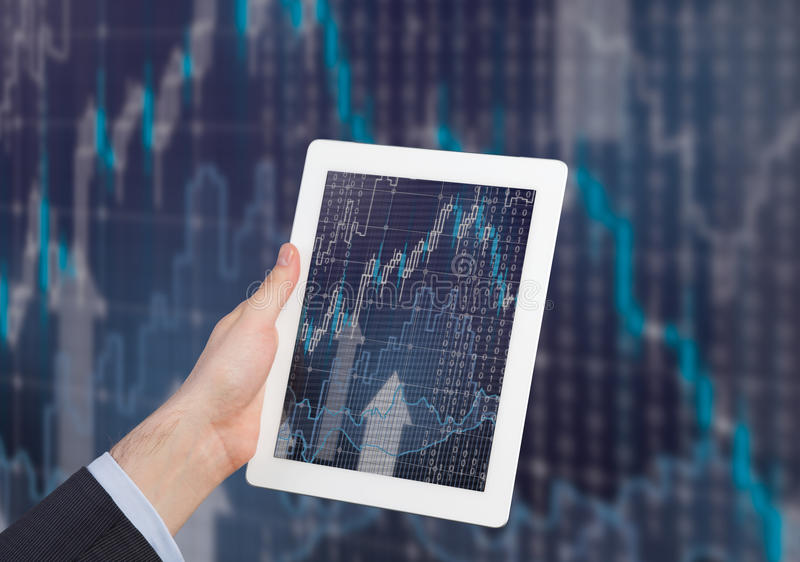 Chart in tablet pc. Hand holding stock chart in digital tablet stock photos