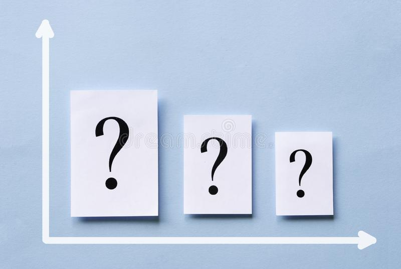 Chart with three white cards with question marks stock photo