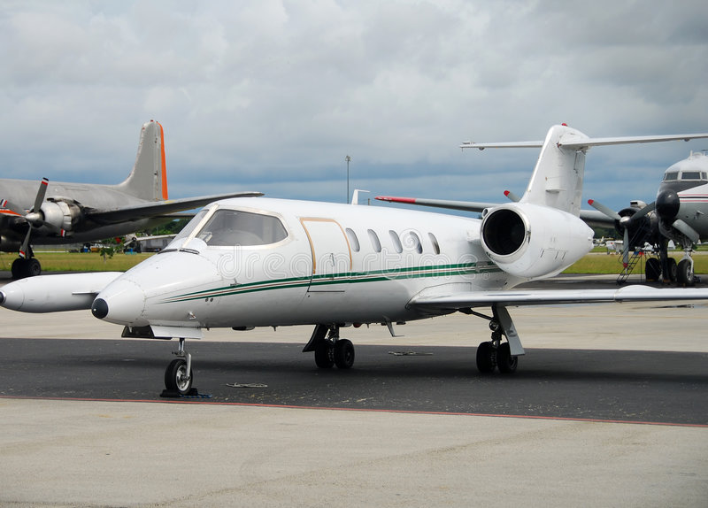 Charter airplane. Private jet parked on runway awaiting VIP clients royalty free stock photography