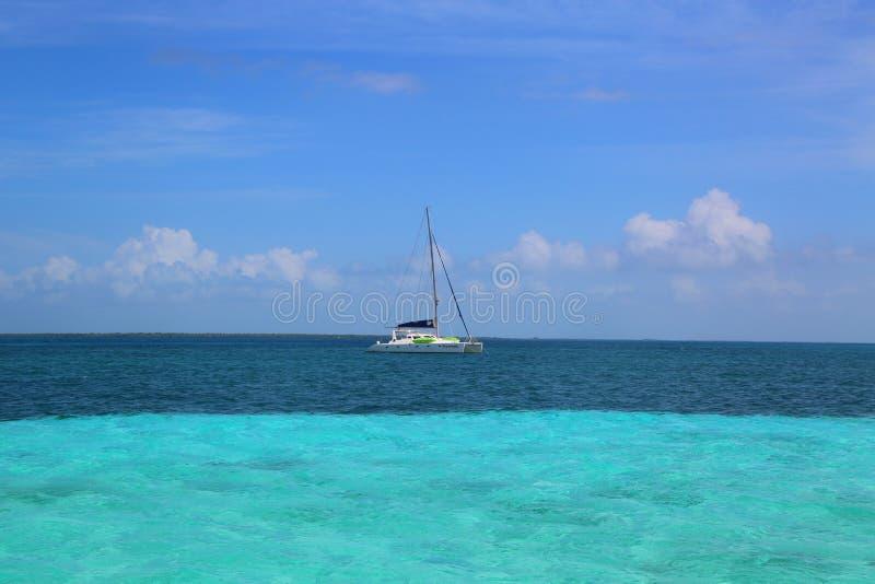Charter yacht near Caye Caulker in Belize royalty free stock photos