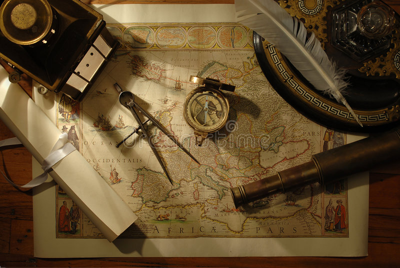 Charting the course. Nautical navigation tools on old world map