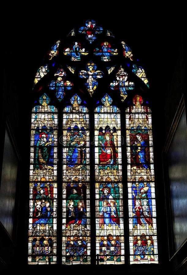 CHARTRES, FRANCE - JULY 19, 2017: Stained glass windows of Chartres Cathedral. Chartres Cathedral is home to the largest collection of preserved medieval stock photography