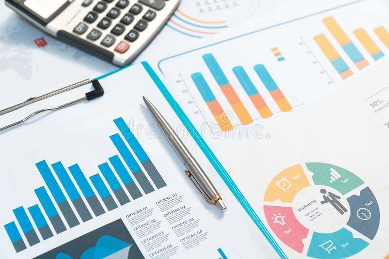 charts. Business reports and pile of documents on gray reflection background royalty free stock photography