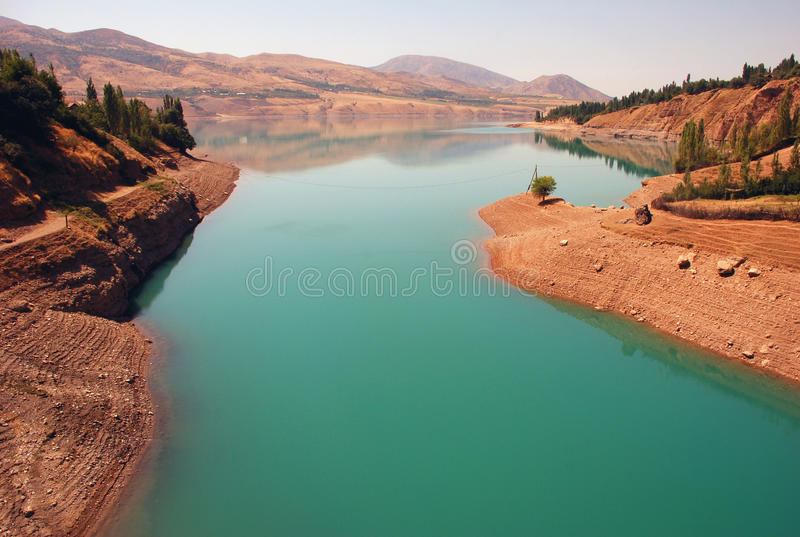 Charvak reservoir at dawn in Uzbekistan stock image