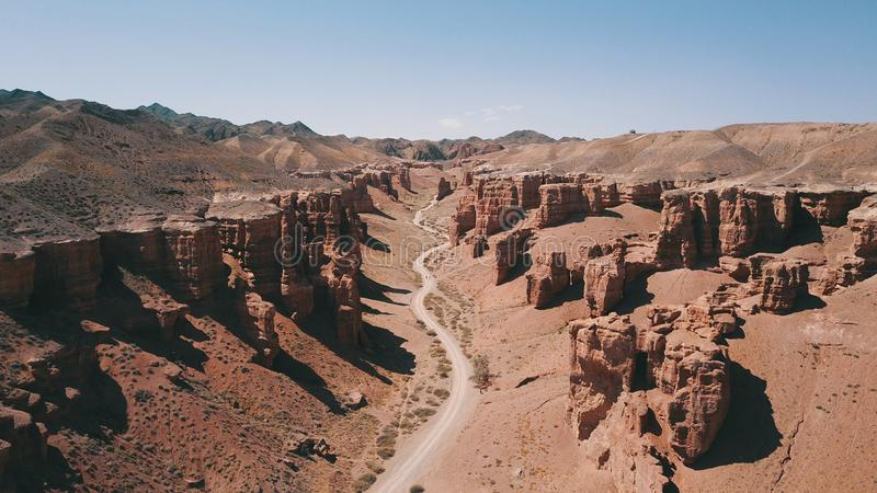 Charyn canyon is the younger brother of the Grand canyon in the United States. Located in Kazakhstan. Visible layers of earth rock, huge crevices, hills and a royalty free stock photography