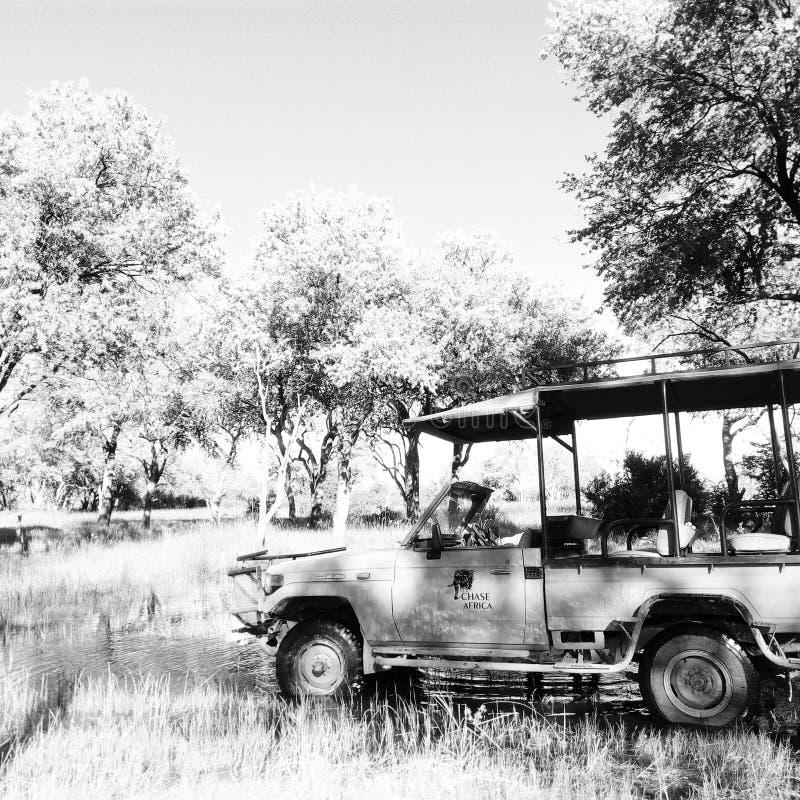 Chase Africa Safaris. Landcruiser crossing water in Khwai, Okavango Delta Botswana stock images