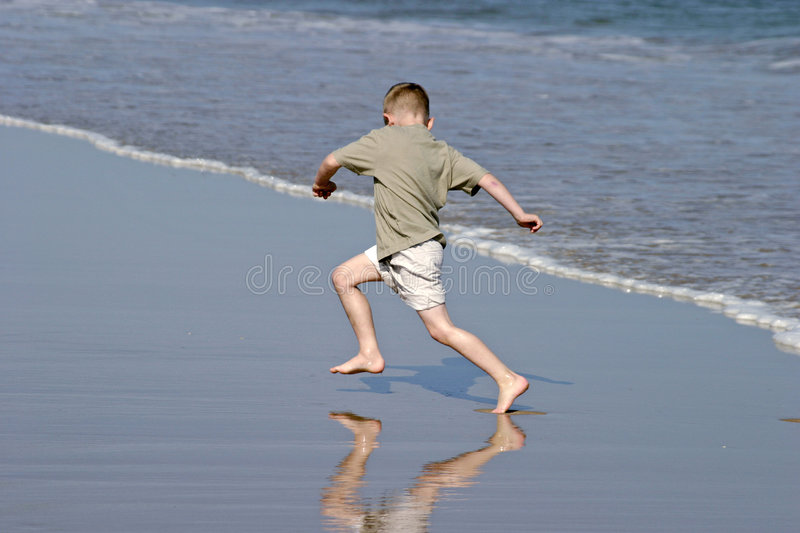 Chasing Waves royalty free stock photography