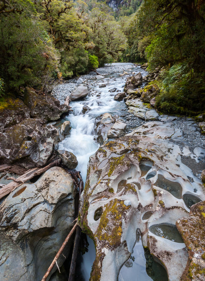 The Chasm at Milford Sound. Rocks sculpted by the Cleddau River at The Chasm in the Fiordland National Park near Milford Sound, New Zealand royalty free stock images