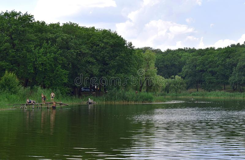 Chasov Yar, Ukraine, on July 14, 2018; pond on the outskirts of Sasovoi Yar. Rest on the shore of the pond on a day off royalty free stock photo