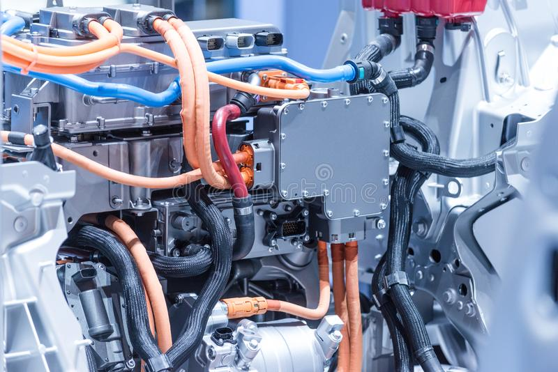 Chassis of the electric car with powertrain and power connections closeup. Blue toned. stock photo