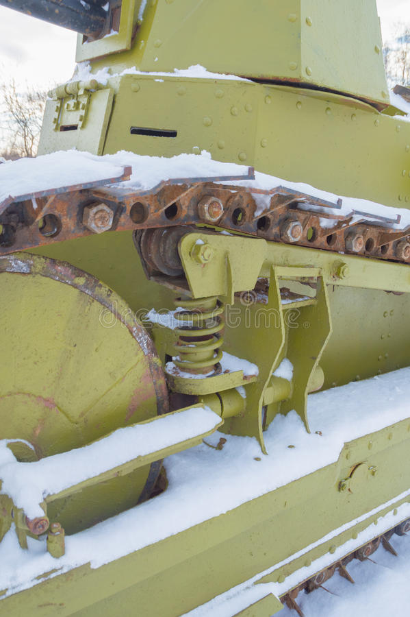Chassis tank in the winter. The tank tracks and the tracks under the snow royalty free stock photo