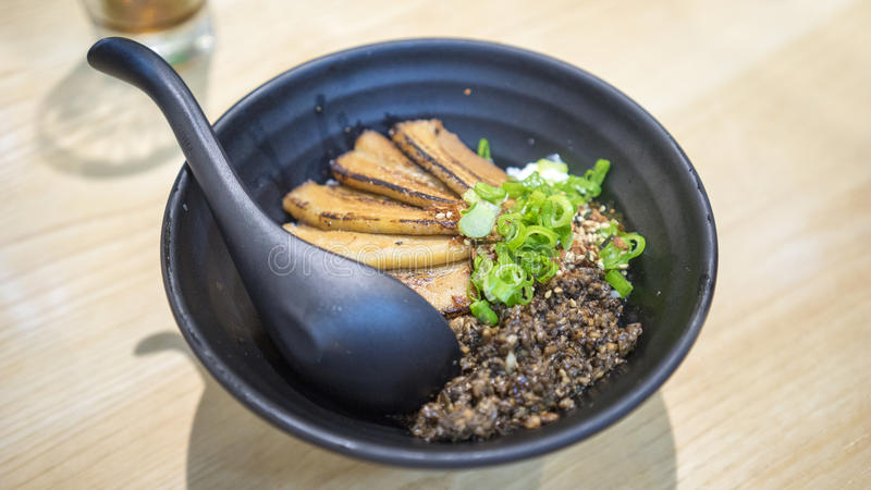 Chasu Donburi. From a Singaporean restaurant. Chasu is a dish made of fattier cuts of pork that are braised over low heat for a very long time. This one is stock photo