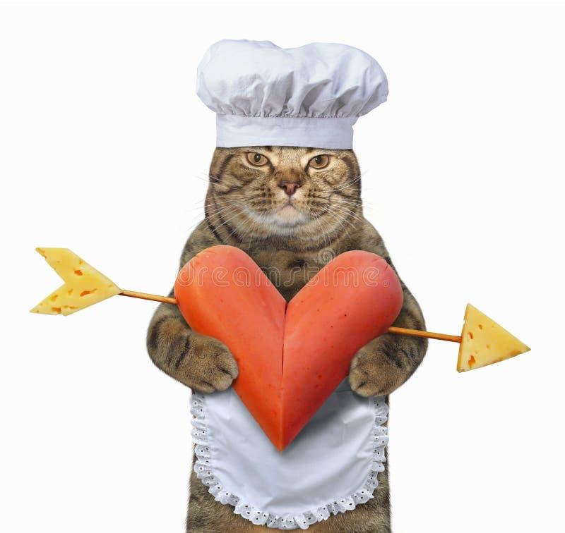 Chat avec une saucisse en forme de coeur 2 photos libres de droits