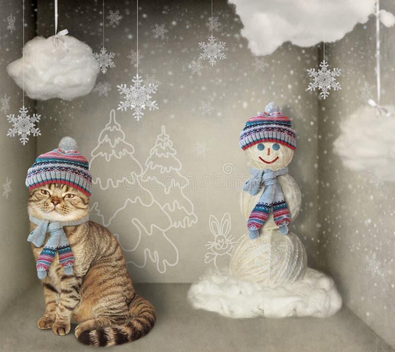Chat et bonhomme de neige photographie stock