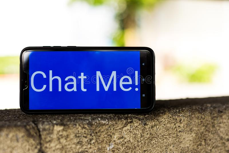 Chat me text in smartphone isolated blue background. Gadget, technology, telecommunication, electronic, modern, lifestyle, sosialmedia, socialmedia, netizen stock photography