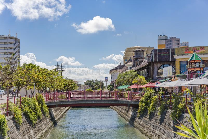 Chatan City river and red steel bridge in the American Village royalty free stock images