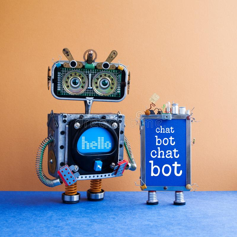 Chatbot artificial intelligence poster. Creative design robot and smartphone gadget with message Chat Bot on blue screen. Modern electronic marketing stock photo