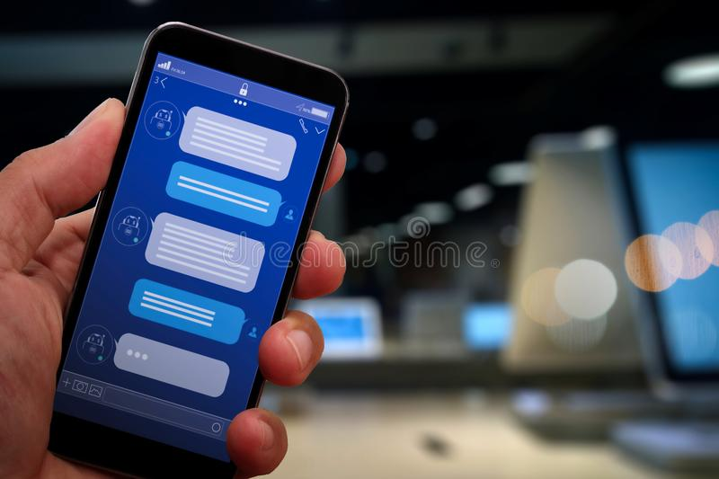 Chatbot conversation with smartphone screen app interface and artificial intelligence technology royalty free stock photo