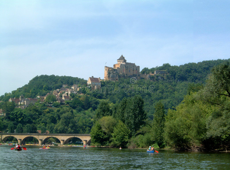 Chateau above Dordogne. Canoeing on the Dordogne with Chateau in the background royalty free stock photography