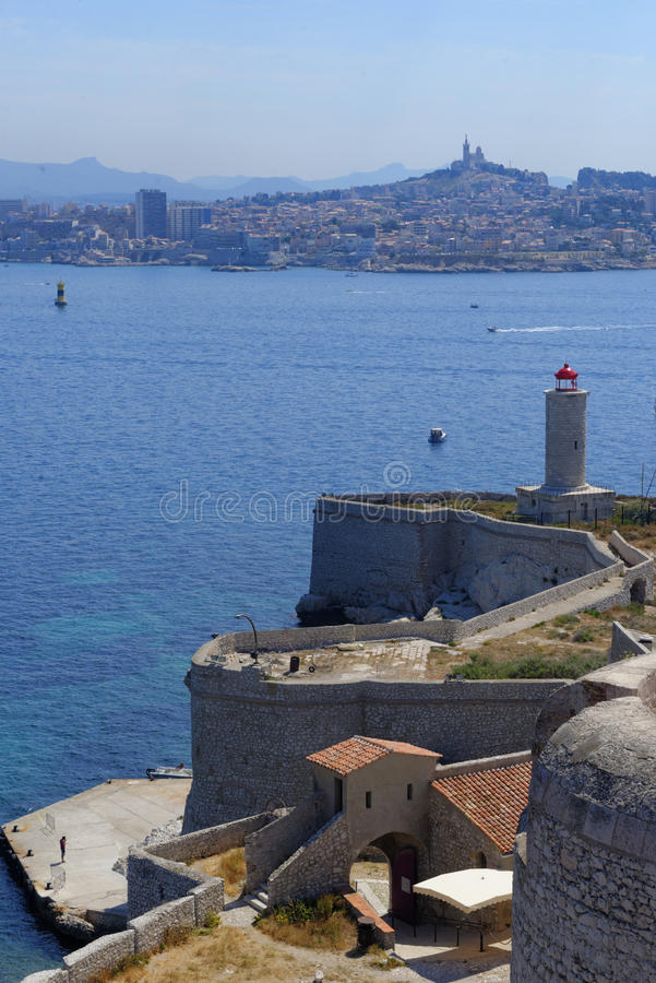 Chateau d'If, Marseille. Chateau d'If fortress in the foreground with a distant view of the city, across the Bay of Marseille in southeastern France stock photos