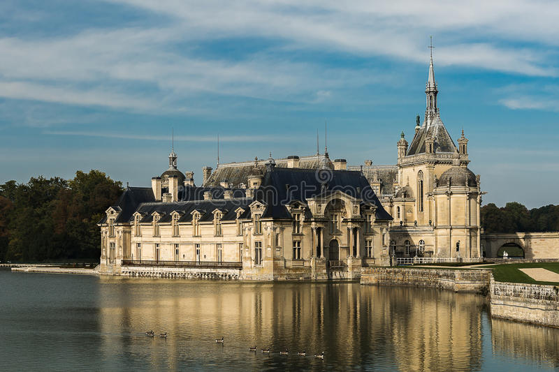 Chateau de Chantilly. And the geese crossing the pond stock photo