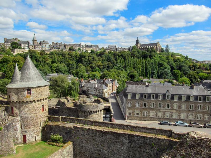 The Chateau de Fougeres: Medieval black roofed castle and town on the edge of Brittany, Maine and Normandy, Fougeres, France. Landscape View of the Medieval royalty free stock photos