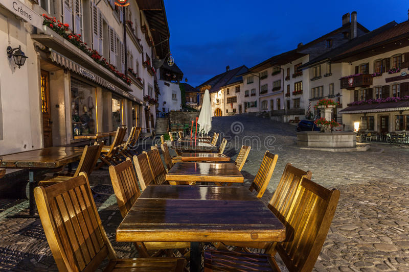 Chateau La Gruyere, Switzerland. Night view of Chateau La Gruyere, a charming and picturesque medieval village in Switzerland, famous for its cheese royalty free stock images