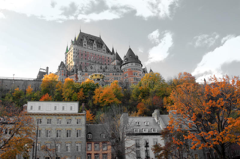 Chateau in Quebec city, Canada. Beautiful color manipulated architectural chateau building in Quebec City, in the province of Quebec, Canada, with fall trees in royalty free stock photo