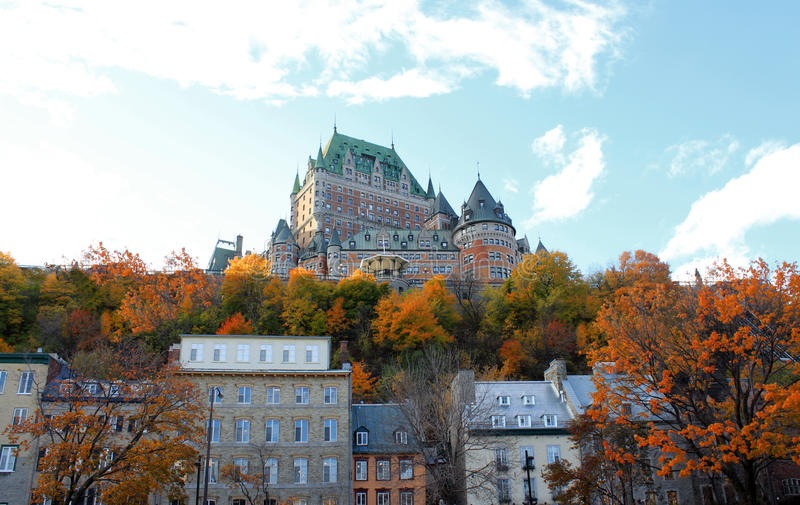 Chateau in Quebec city, Canada. Beautiful architectural chateau building in Quebec City, in the province of Quebec, Canada, with fall trees in the foreground royalty free stock image