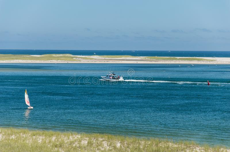 Chatham Lighthouse Beach, MA, USA. Fisherman boat sailing at The Chatham Lighthouse Beach in Cape Cod Massachusetts, USA royalty free stock images