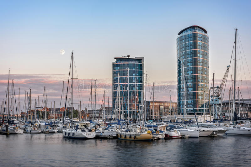 Chatham maritime marina at sunset. Chatham, United Kingdom - August 27, 2015: Chatham maritime marina at sunset. Reflection on water, yachts, two modern stock photography