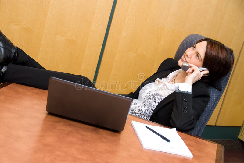 Chatting. Relaxed woman happy on the phone chatting stock photography
