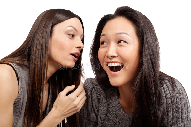 Chatting. Sharing a story and a laugh royalty free stock image