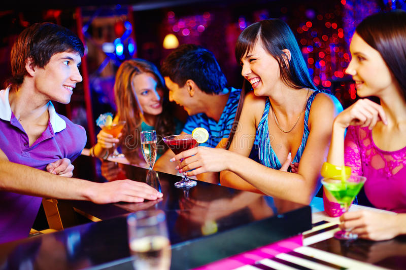 Chatting in bar stock images