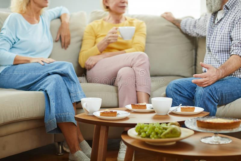 Chatting during tea party stock photos