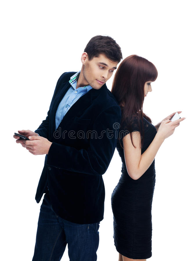 Chatting with who?. Man is curious with whom she is chatting stock photo