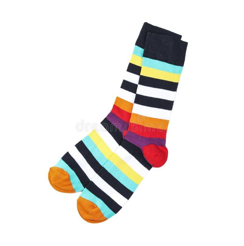 Chaussettes colorées sur le fond blanc images stock