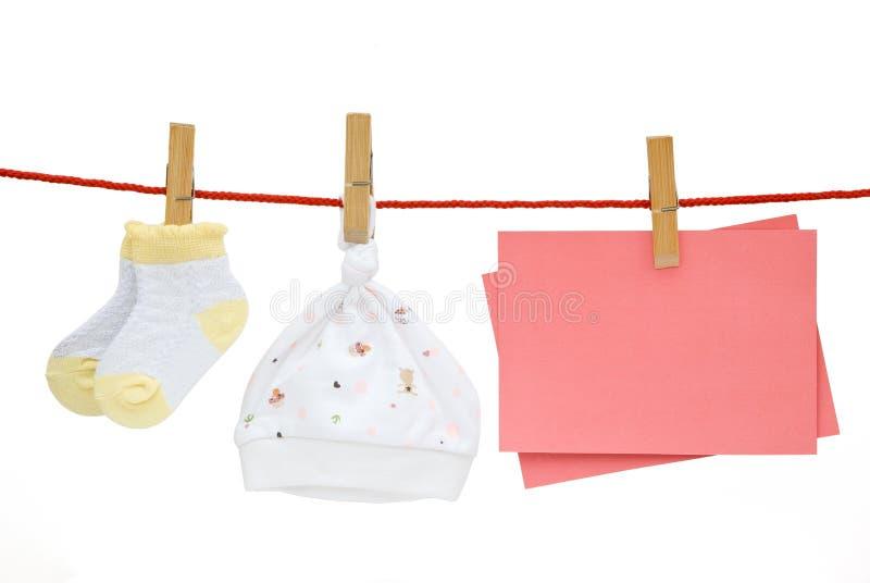 Chaussettes de chéri et capuchon et note blanc image libre de droits