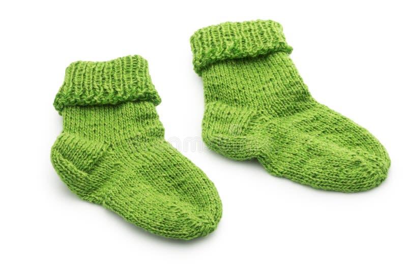 Chaussettes de laine d'enfant d'isolement sur le blanc photographie stock libre de droits