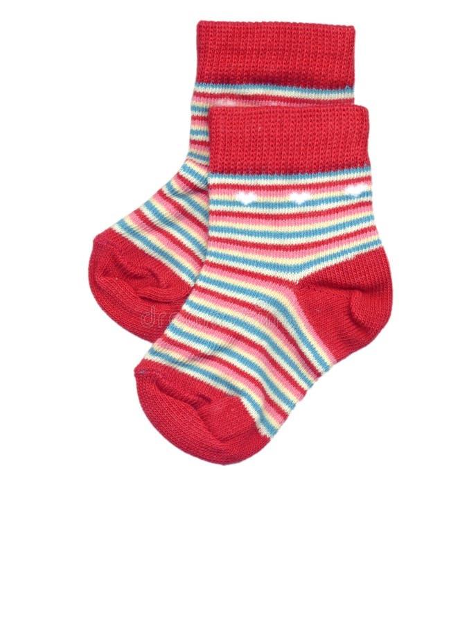 Chaussettes rayées d'enfant en bas âge images stock