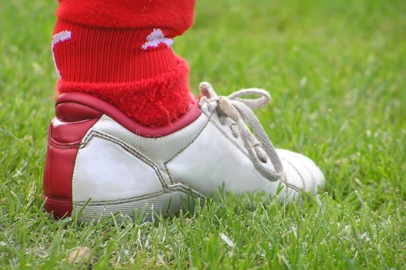 Chaussure du football image stock