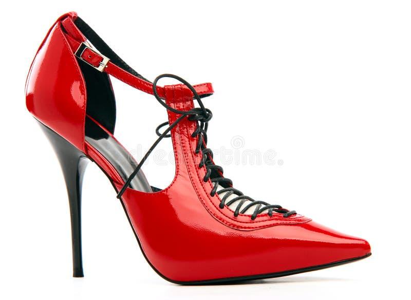 Chaussure femelle rouge avec un laçage sur un stylet image stock